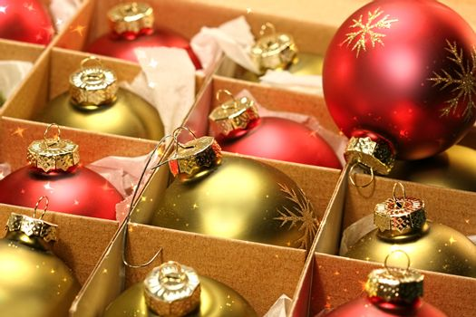 Christmas balls in box with paper wrapping