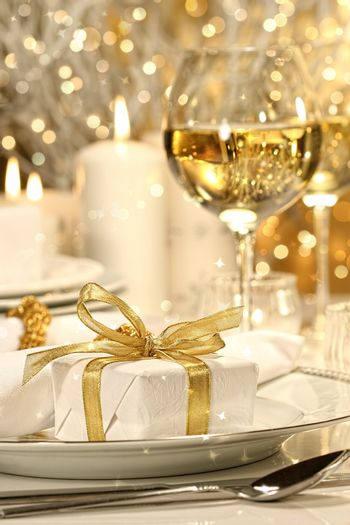 Gold ribbon gift with gold background