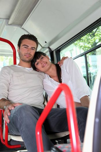 Couple sitting on a bus