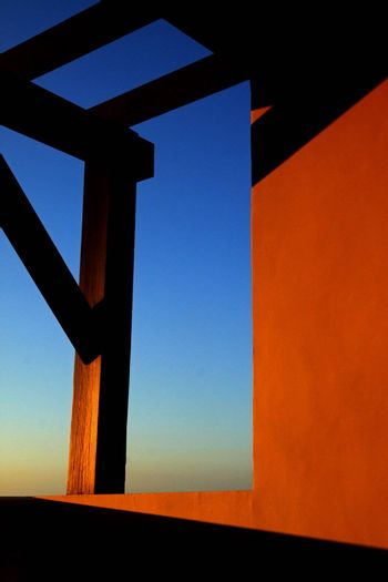 Sunset shadow and warm beams with orange glow on  a tropical balcony