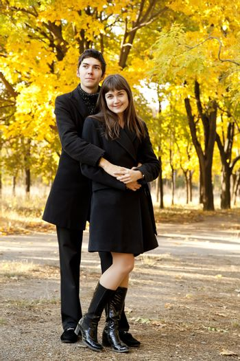 Couple in the park in fall
