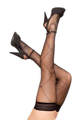 A pair of legs crossed wearing lacy stockings and heels.