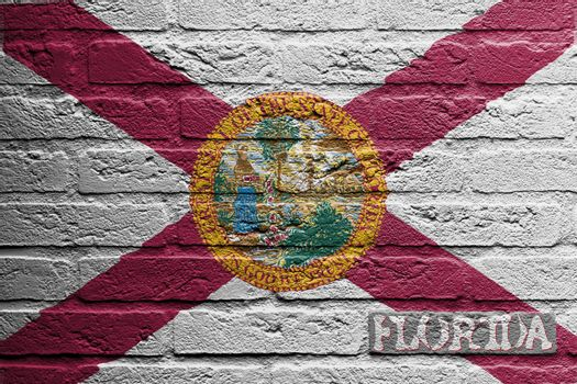 Brick wall with a painting of a flag isolated, Florida