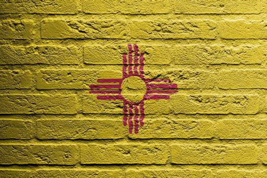 Brick wall with a painting of a flag, New Mexico