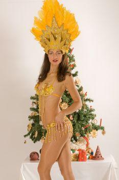Beautiful samba girls celebrating Christmas with a Bavarian Christmas tree