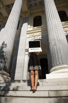 dress woman showing portable between columns