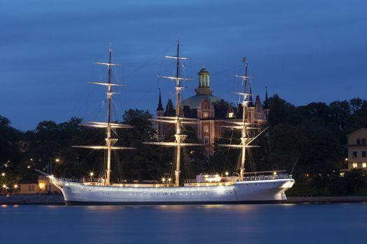 Sailboat in Stockholm at dusk