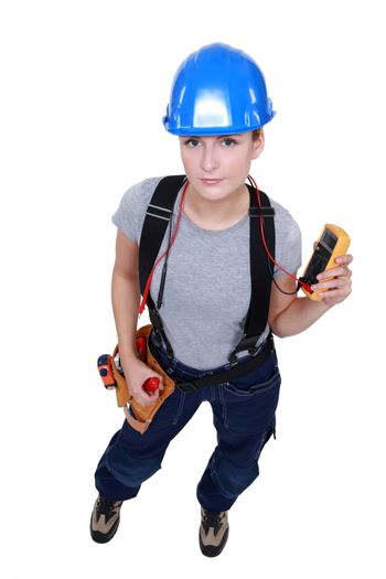 Female electrician taking reading