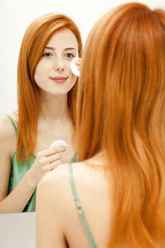 Redhead girl in bathroom