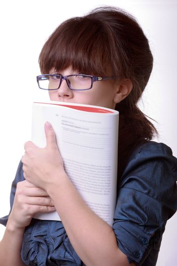 Portrait of young alluring brunette woman, holding book