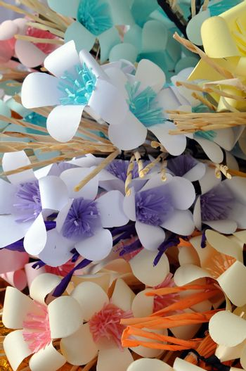 Artificial flowers are imitations of natural flowering plants, used for commercial or residential decoration.