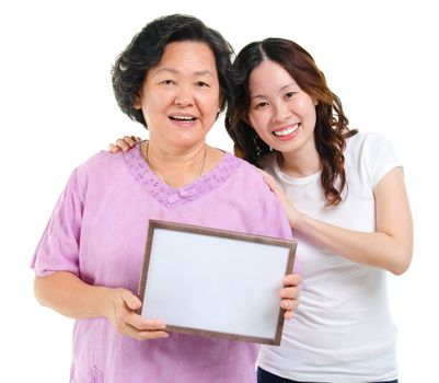 Asian family holding a blank board