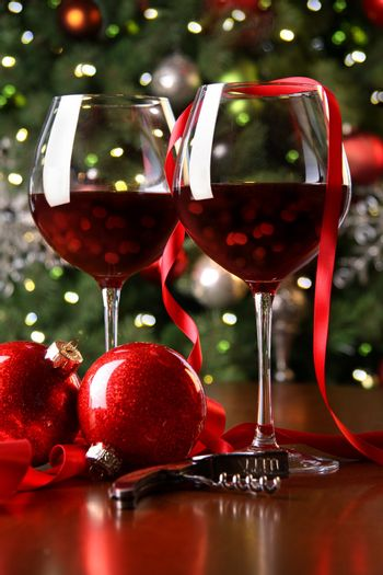 Holiday background with glasses of red wine