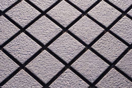 Close up of diamond shaped stone street tiles