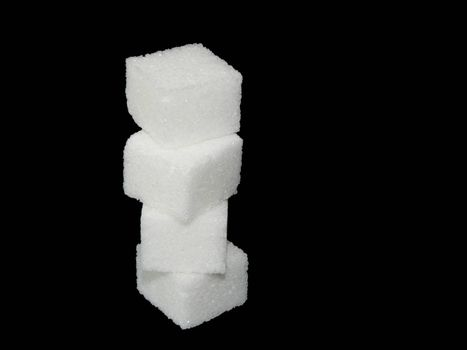 Sugar cube on black background