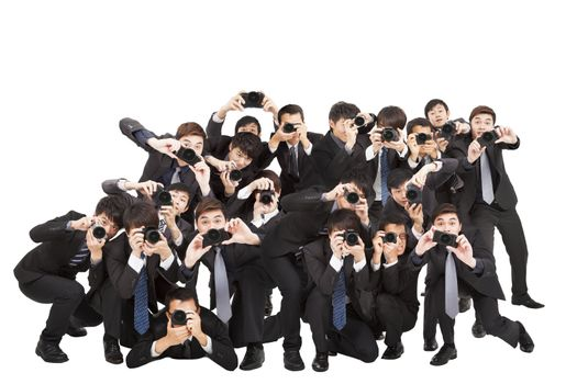 many photographers holding camera pointing to you