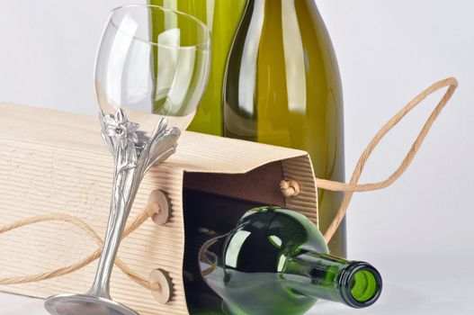 Here is a lovely composition of empty wine bottle and glass.