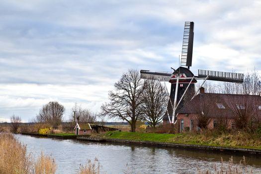 Dutch windmill by canal