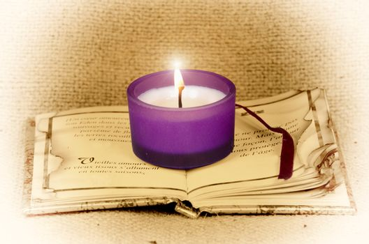 create poetic atmosphere with this candle on a book