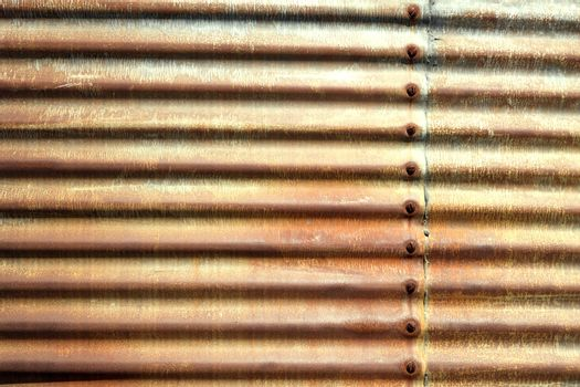 Side of building with old rusted corrugated metal.