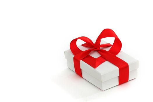 white christmas gift with red heart ribbon