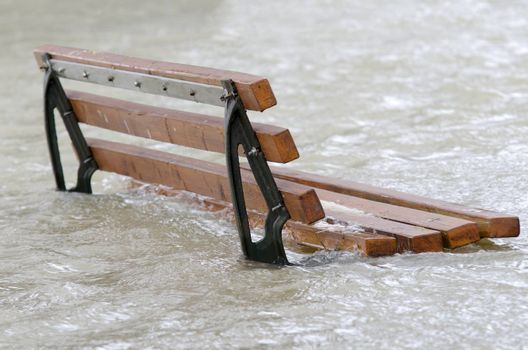 a bench surrounded by water
