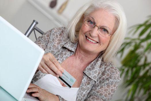 Elderly lady shopping on-line