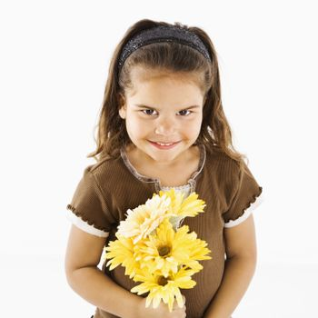 Lttle hispanic girl holding bouquet of yellow flowers.