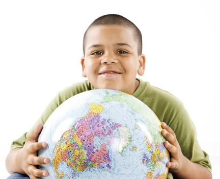 Young latino adolescent boy holding globe.