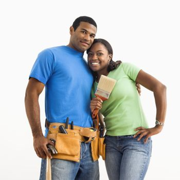 Portrait of African American male and female couple with home repair tools.