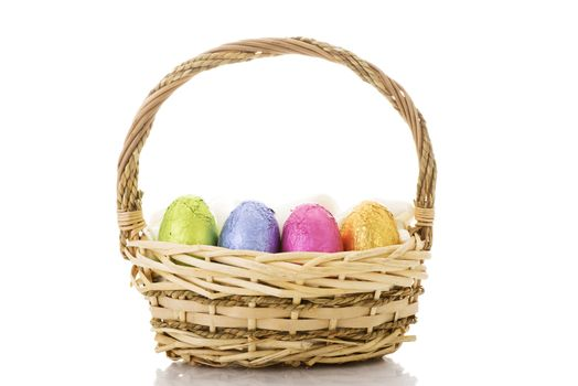 Wicker easter basket isolated on white