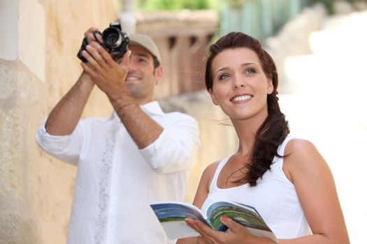 Tourists photographing monuments