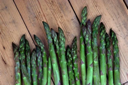 Asparagus heads on a bench in the garden