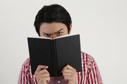 studio shot of Man holding open book