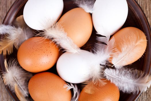 eggs and feathers in a plate