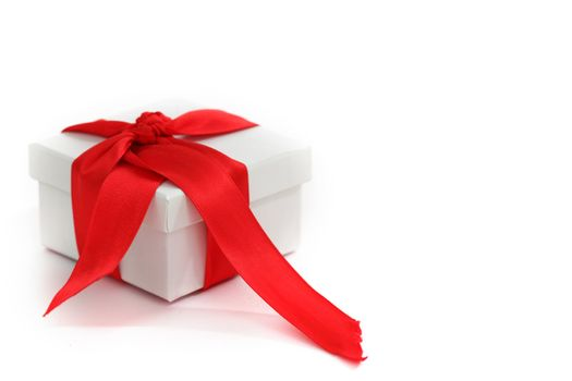 white christmas gift with red ribbon
