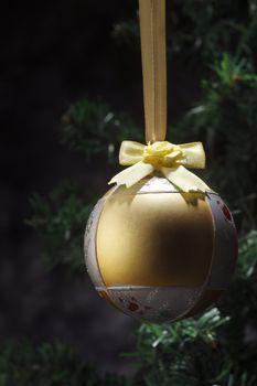 Christmas tree with a christmas ornament.