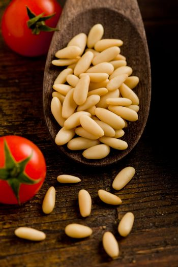 Pine nuts on wooden spoon