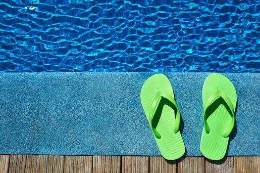 Slippers by a swimming pool