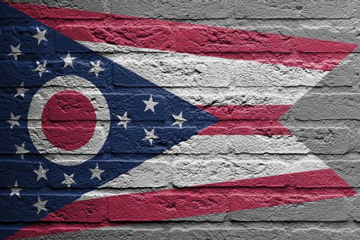Brick wall with a painting of a flag, Ohio