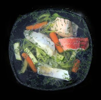 Tasty soup of a fish with vegetable marrows and carrots