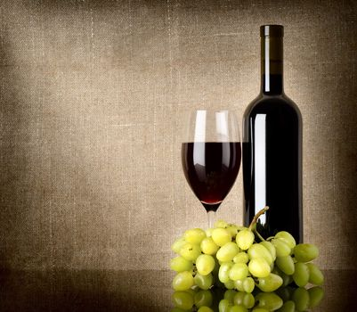 Dry red wine and grapes