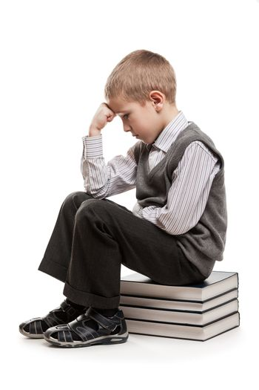 Thinker child sitting on reading books