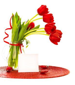 Red tulips bouquet in vase