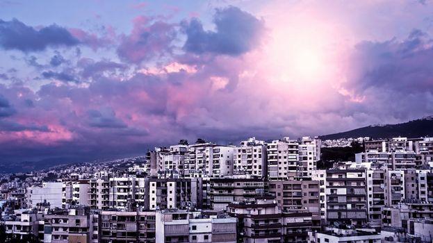 Purple sunset over city