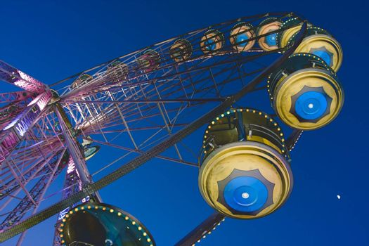Big wheel in a amusement park by night. With solarisation effect.