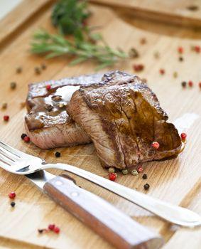Steaks On a Wooden Board