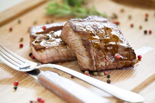 Two Steaks On a Wooden Board