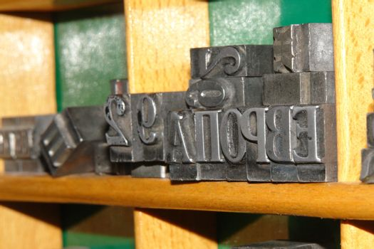 Typography letters shelf. old metallic letters for printing
