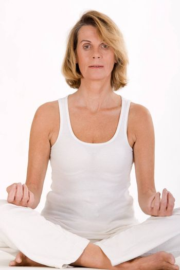 Older lady finds relaxation in yoga